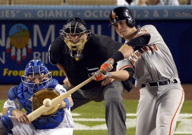 Giants atop the NL West after sweeping Dodgers