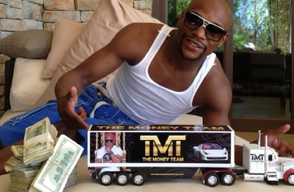 9-his-the-money-team-hess-truck-next-to-stacks-of-cash