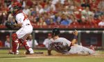 Reds Open Series With Cardinals in NL Central
