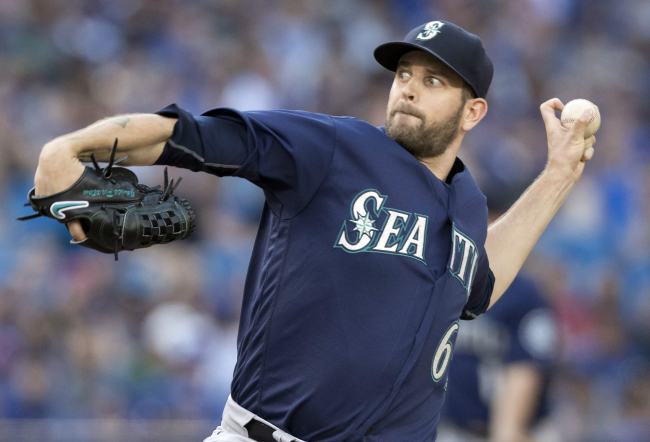 Seattle Mariners starting pitcher James Paxton throws against the Toronto Blue Jays during the first inning of a baseball game in Toronto, Friday, July 22, 2016. (Fred Thornhill/The Canadian Press via AP)